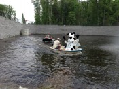 boating with the chick-fil-a cow at the retaining wall pond