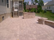 Concrete Paver Patio with sitting wall and grilling area