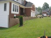 retaining wall in front of house