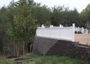 retaining wall with white fence